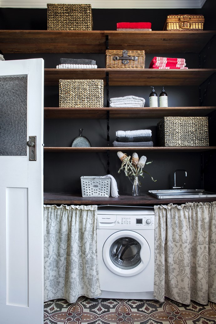"""I love that the combined bathroom and laundry is spacious and practical,"" says Carla. ""Rather than having two separate rooms, it was all about maximising the living space."" Ben made the shelves from leftover floorboards, Carla whipped up the curtains."
