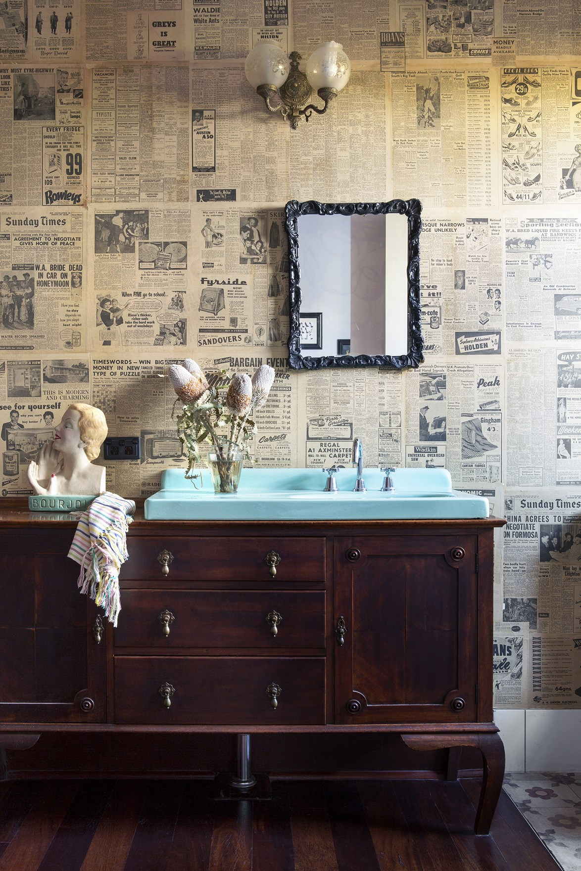 "Ingenuity and a love of upcycling allowed the owners of this [art-deco style home](https://www.homestolove.com.au/gallery-carla-and-bens-art-deco-style-new-house-1798|target=""_blank"") to create a truly unique ensuite bathroom. An antique dresser was transformed into a vanity while the enamel basin was found at a salvage yard. Even the wallpaper is made from old newspapers found in the home."
