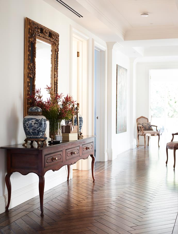 This luxurious oak parquetry transforms a hallway into a design feature. Photo: Derek Swalwell / bauersyndication.com.au