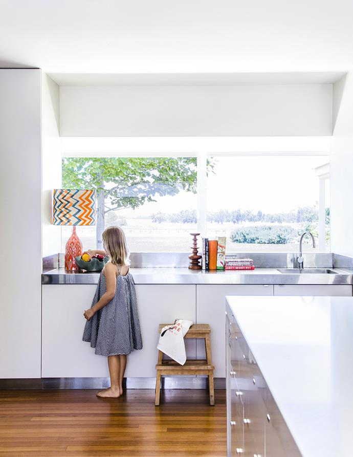 """Mimi stands in the airy and spacious kitchen. The Dimity Kidston lamp is from [Country Culture](http://www.countryculture.com.au/