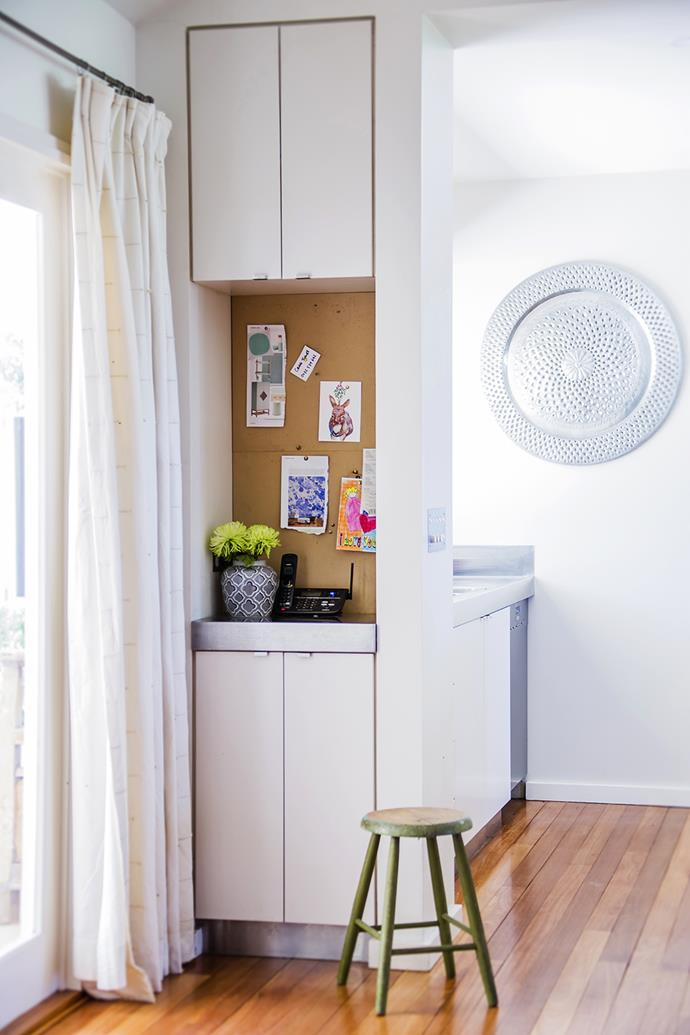 """A pinboard and extra storage turn an awkward nib into a useful space.   The **ginger jar** was a gift and the stool is an heirloom. The silver platter on the wall is from [Mandala Traders](http://www.mandalatraders.com.au/