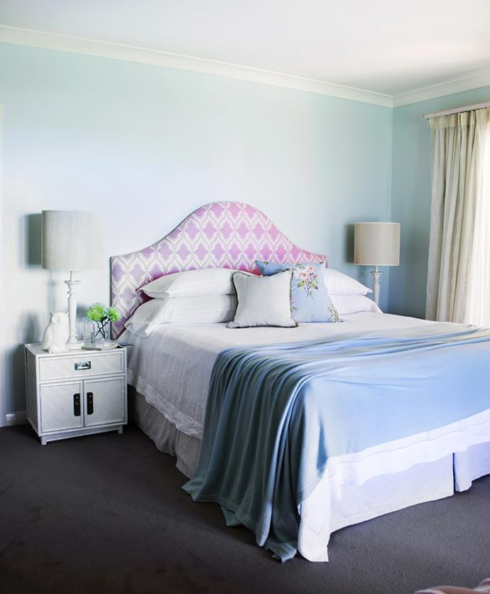 """Sky blue walls and an earth-toned carpet bring the outside in to the main bedroom.   **Bedhead** upholstered in [Christopher Farr Cloth](http://christopherfarrcloth.com/