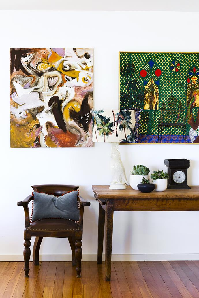 """Artworks by Charles' mother Jenny Lavender (left) and Greg Irvine energise the dining area. The side chair is a family heirloom.   **Table** from [The Country Trader](http://www.thecountrytrader.com.au/