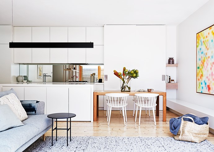 """Calm interiors were a must for the busy family. The artwork above the built-in bench seat is by Matthew Johnson.   For similar **flooring**, try Pine in Brushed White Oil, (2.48m x 18cm) from [Mafi](http://www.mafi.com.au/