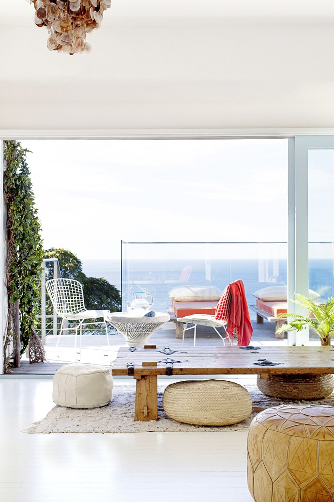 """The chill-out area/sunroom has stunning views of the ocean between Palm Beach and Whale Beach. The wooden table, made from an old Mongolian door, is from [Stone Pony](http://www.stonepony.com.au/ target=""""_blank"""")."""