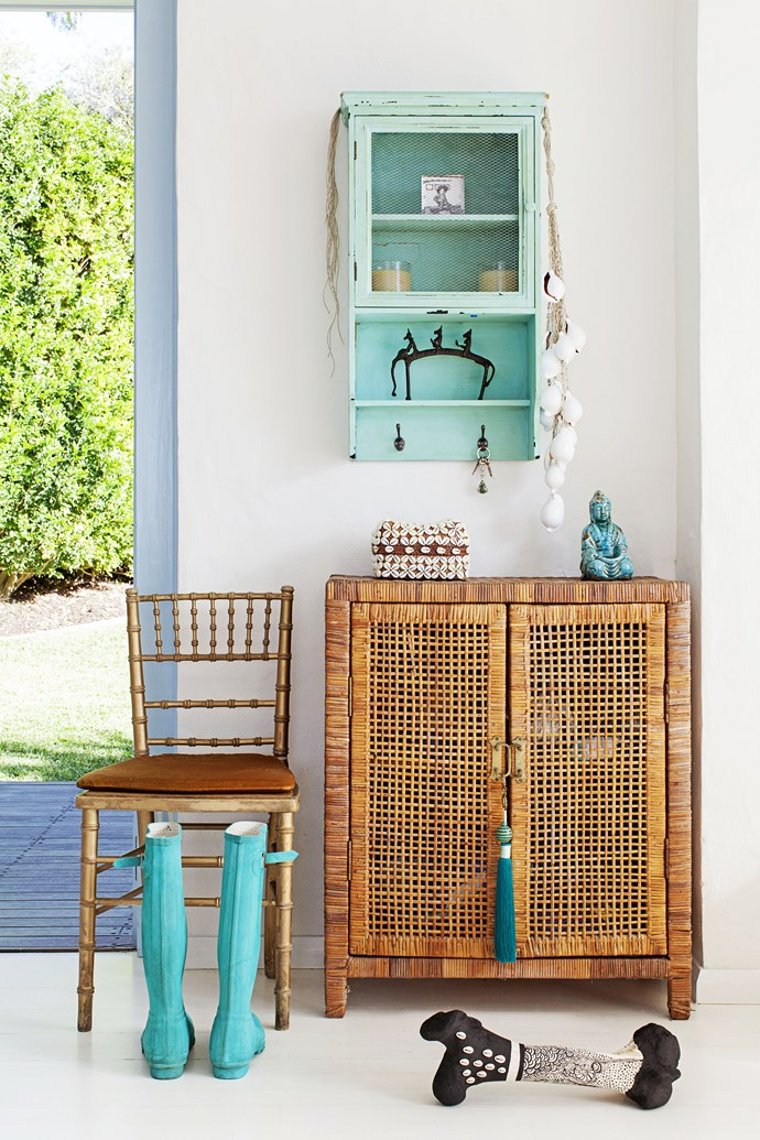 """A [John & Ginger](http://johnandginger.com.au/ target=""""_blank"""") rattan cupboard by the back door houses the family's shoes. Heidi's gum boots and the wall shelves, from Indonesia, fit in perfectly with the colour scheme."""