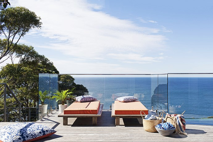 """The ground-floor deck is where Heidi likes to practice her yoga – it overlooks the ocean and gets the morning sun. The timber sun lounges were custom-made by [Beachwood](http://www.beachwood.com.au/ target=""""_blank"""")."""