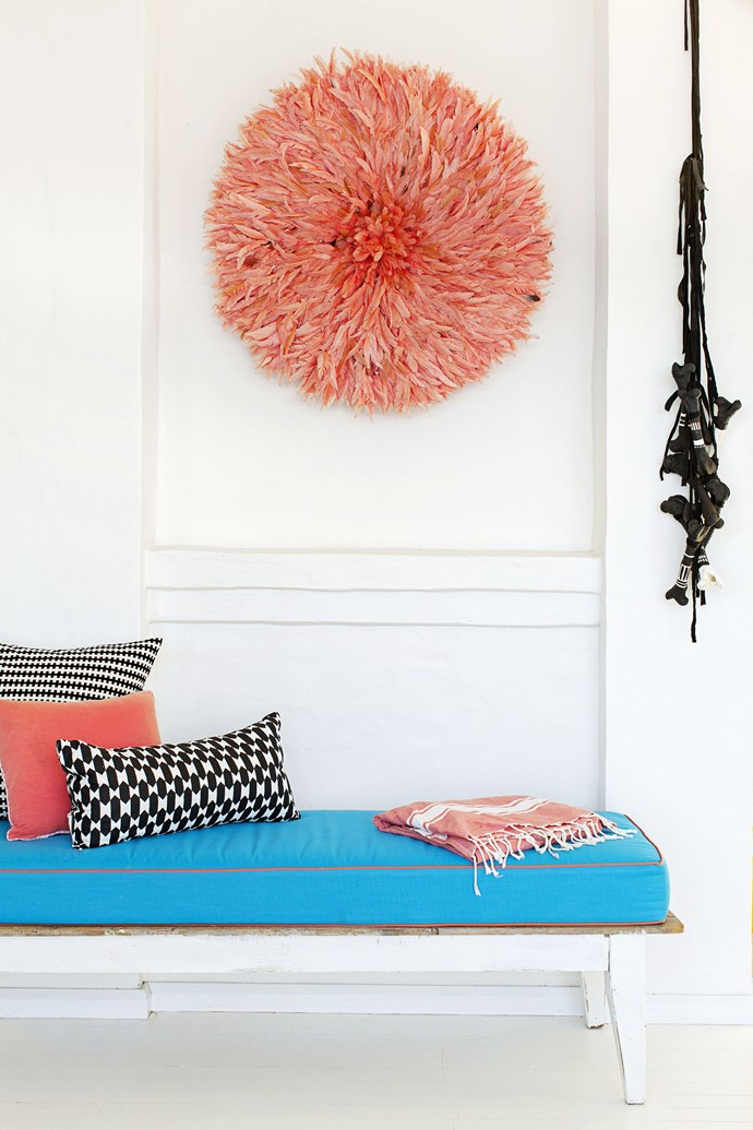 """A Bamileke feather headdress from [Table Tonic](http://www.tabletonic.com.au/ target=""""_blank"""") adds a soft, whimsical feel to the sunroom."""