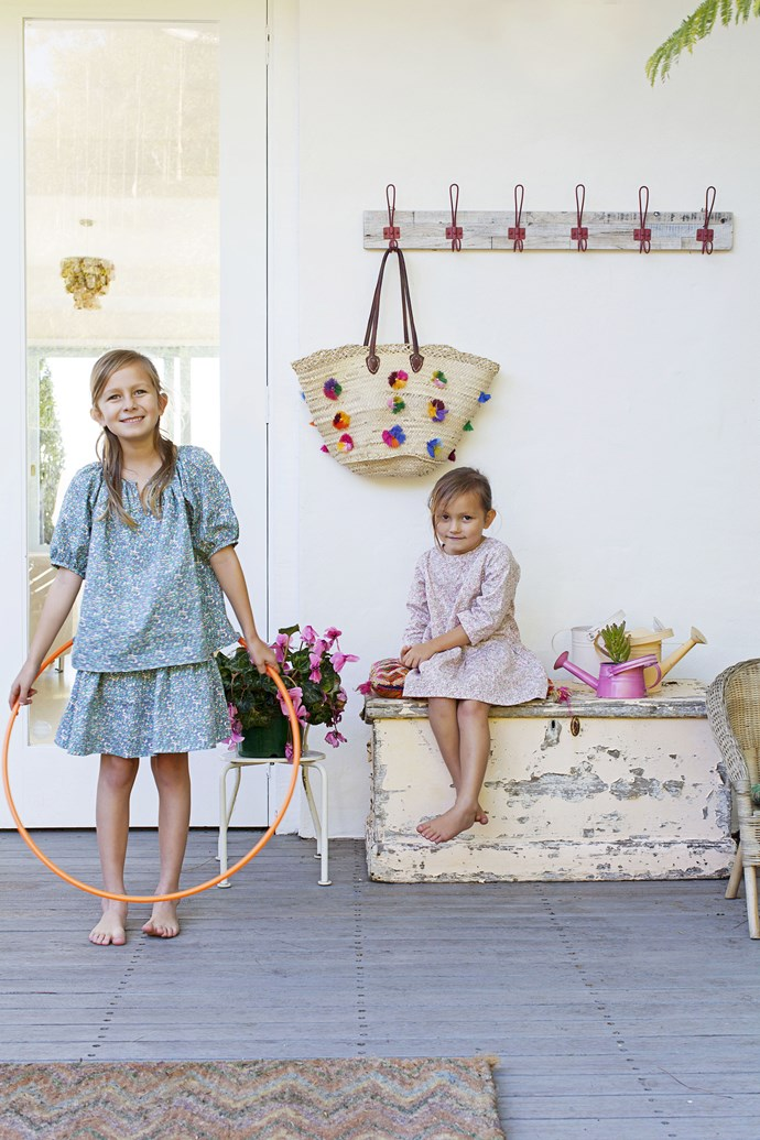 """Ella and Gisele love to play on the back verandah. The coat rack is from [Rust](http://www.rustonline.com.au/ target=""""_blank"""") in Avalon and the worn chest was a lucky antique find."""