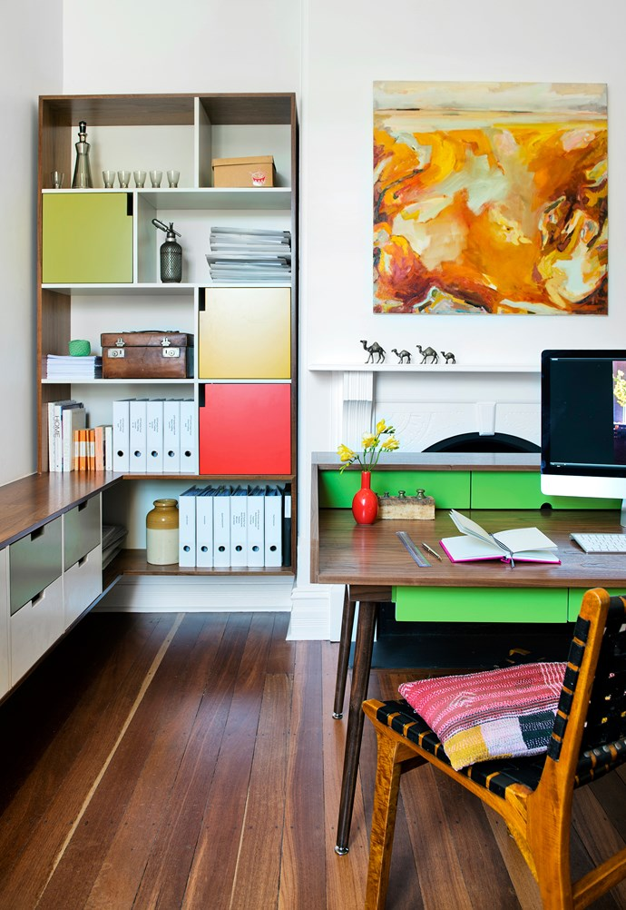 The colourful built-in cabinetry and coordinating desk were designed by architect Sam Klopper and built by Benchmark Cabinets. The *West* artwork is by Jo Darvall. The jarrah floor is original.
