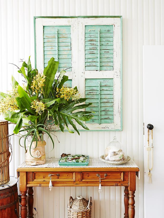 Old shutters in a frame make for a quirky artwork. The colour sets the tone for the home.