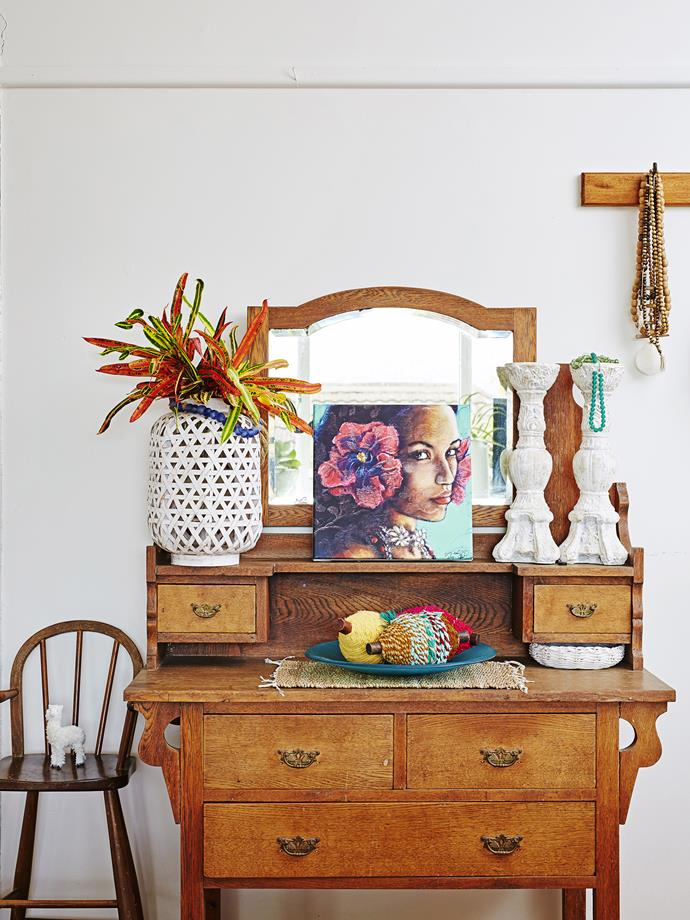 An old dresser was repurposed as a hall stand in the entryway. Di bought it from a neighbour for only $30!