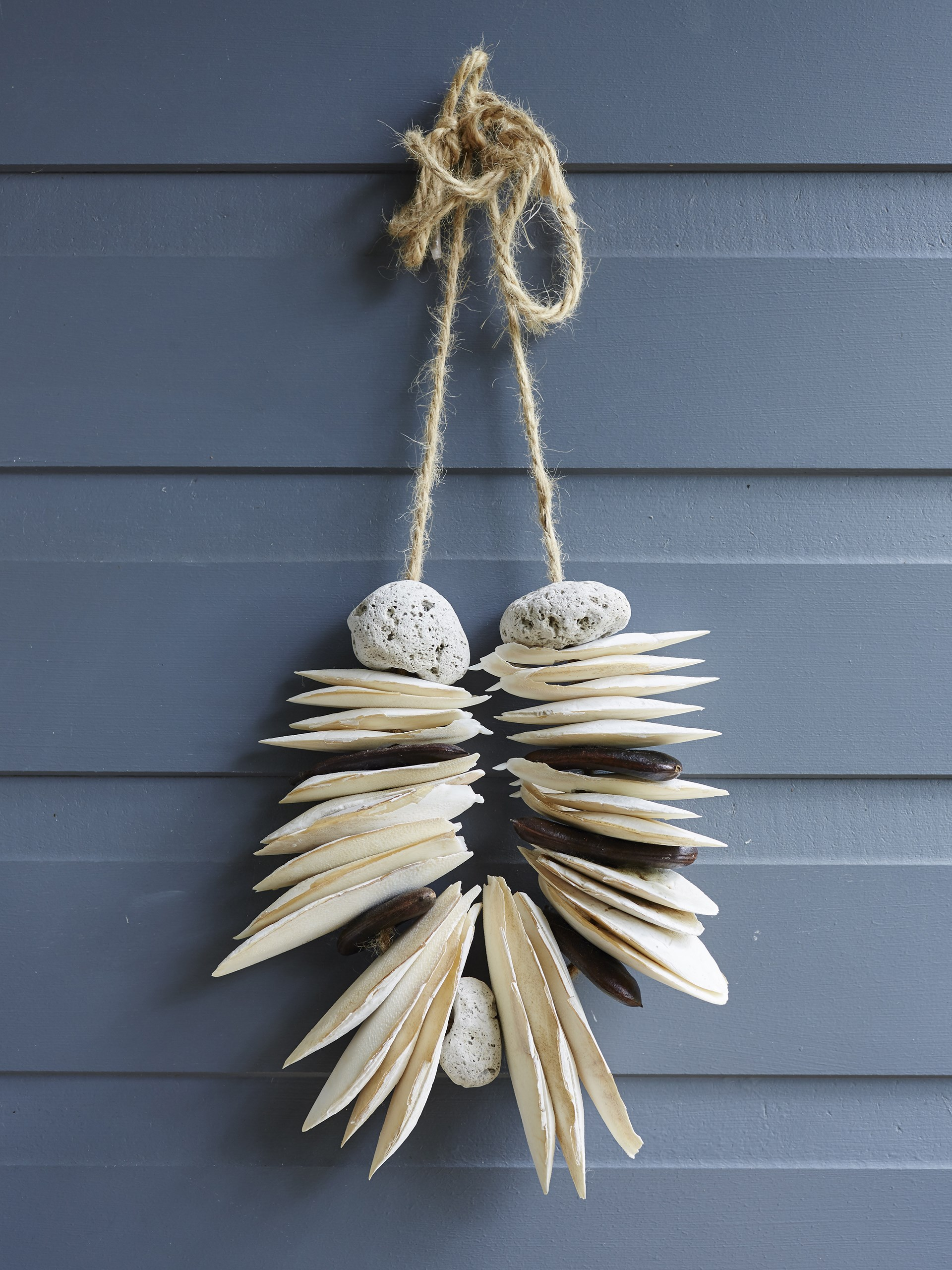 """Beachy finds make a great decoration when strung on rope, as seen in this coastal weatherboard cottage](http://www.homestolove.com.au/gallery-dis-coastal-cottage-style-1837