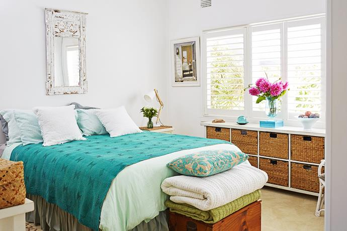 """The master bedroom of Di Nash's weatherboard cottage is a sanctuary in teal. The beachy basket shelving unit is from [Beachwood](http://www.beachwood.com.au/