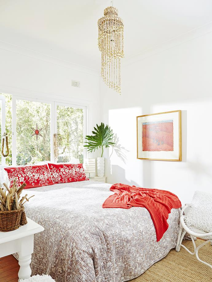 """The guest bedroom has a red and white theme with linen from [Jasmine Hall](http://jasminehall.com.au/