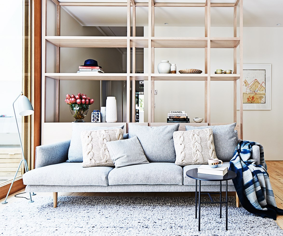 "This [custom-made joinery unit](http://www.homestolove.com.au/penny-and-andrews-fresh-edwardian-house-renovation-1828/|target=""_blank""), wraps from the hallway to the living area facilitating a smooth transition between zones with an open-plan feel."