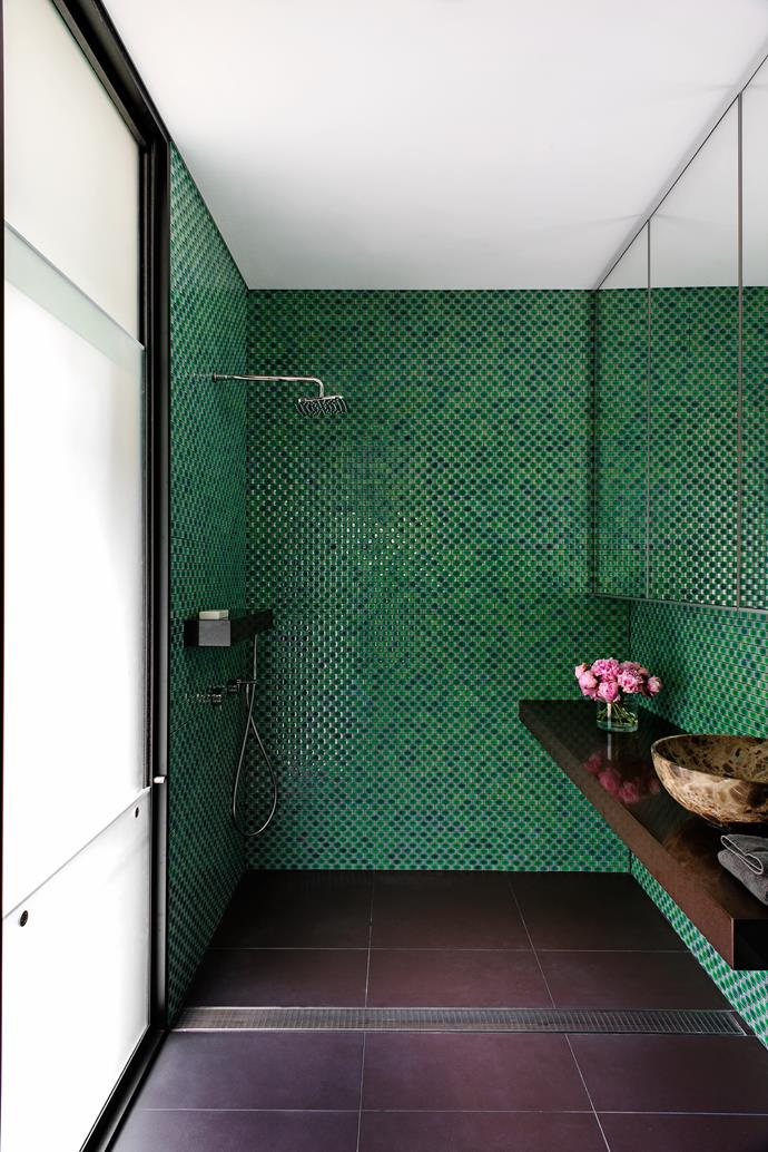 "Generous proportions and a balanced selection of materials create a tranquil, soothing haven. ""Our aim was to create a bathroom with a calm, somewhat mysterious atmosphere that envelops the user,"" say designers Scott Weston and Gregory Phillips of Scott Weston Architecture Design.   Arc concave glazed **tiles** in Green from [Artedomus](http://www.artedomus.com/