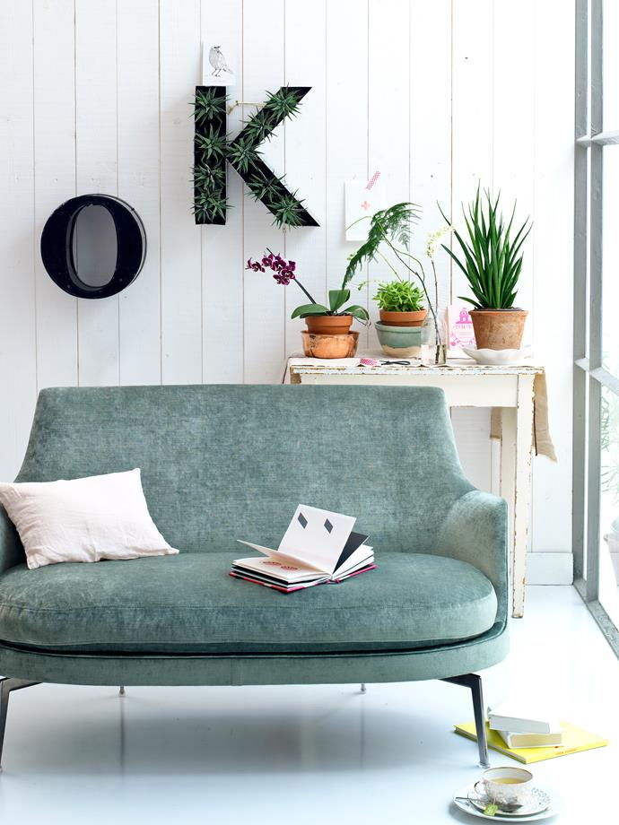 Think outside the square when it comes to pots and planters. Here, the letter 'K' has been filled with aloe succulents and mounted on the wall.