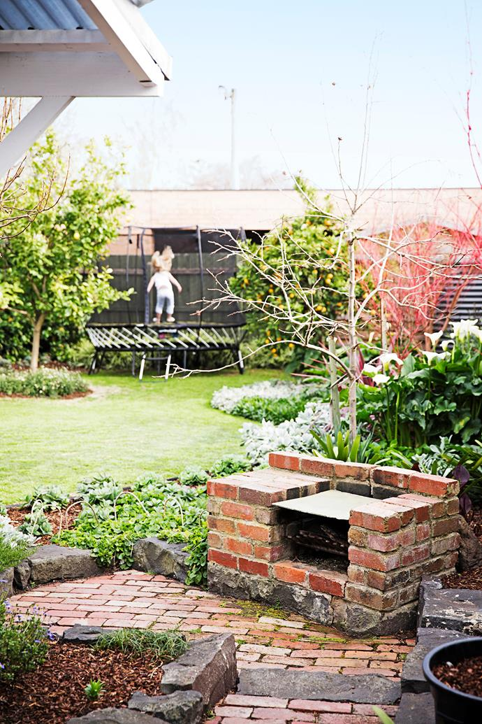 """The family love entertaining, too. """"The backyard is great for a barbecue and a drink with friends,"""" Claire says. Alex made the barbecue and the paving using recycled bricks."""