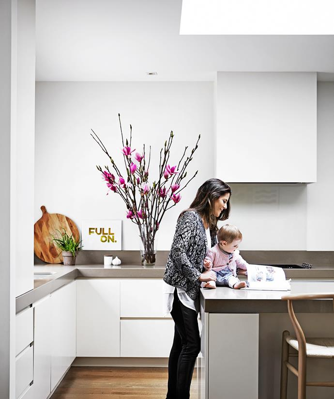 "The kitchen had been renovated prior to purchase, but Georgina, pictured with daughter Heidi, painted the walls in [Dulux](http://www.dulux.com.au/?utm_campaign=supplier/|target=""_blank"") Whisper White.   Replica Hans Wegner Wishbone **stools** from [Sokol](http://www.sokol.com.au/?utm_campaign=supplier/
