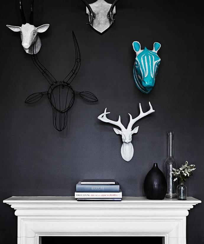 "Black painted walls add drama in the smaller front living room, allowing sculptural animal heads to ""pop"".   Decorative **zebra** and **cow heads** from [Turner and Lane](http://www.turnerlane.com.au/?utm_campaign=supplier/