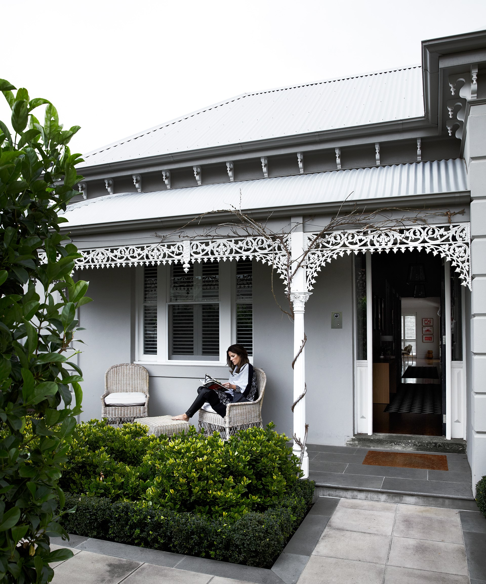 The monochrome theme of the interior extends outside to the front verandah of this double-fronted brick home in Melbourne. Take a look inside this [Victorian-era home](http://www.homestolove.com.au/gallery-georginas-monochrome-home-renovation-1871). Photo: Sharyn Cairns / *real living*