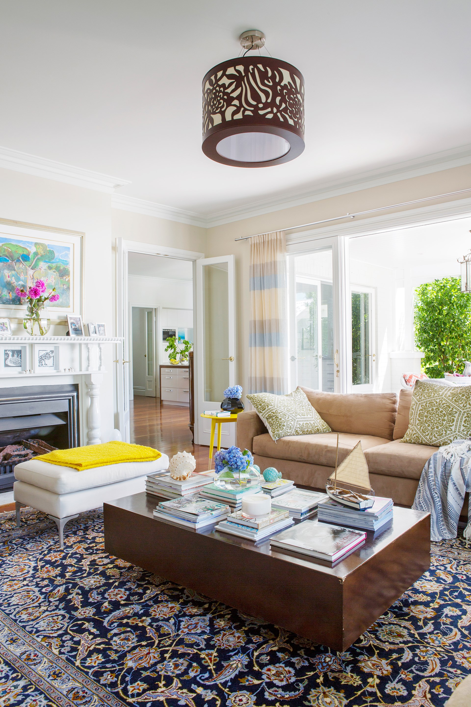 "A large Persian rug sets the scene for lounging in comfort in this [warm and welcoming heritage home](http://www.homestolove.com.au/gallery-rundown-perth-property-gains-a-new-life-1874|target=""_blank""