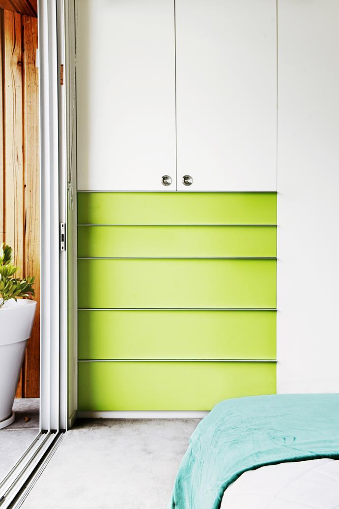 The green in the bedroom shifts to a different shade on the wardrobe – a cheerful apple green.