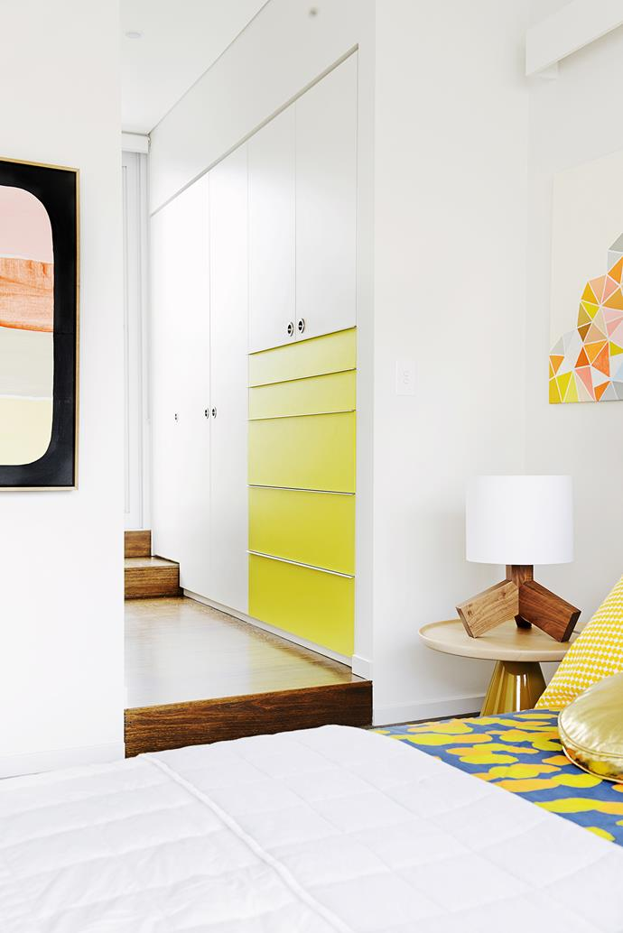 Known for his innovative and award-winning use of colour, Scott has given each bedroom a different joinery colour. This one is yellow, echoed in the choice of bedding and artwork.