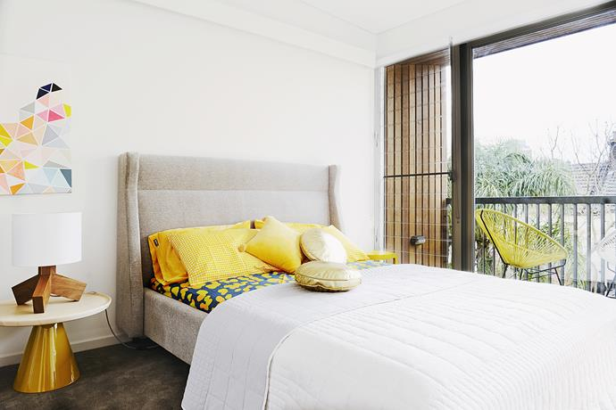 The main bedroom feature gorgeous pops of yellow. In each of the bedrooms, LED lights run along a slim bulkhead above the bed.