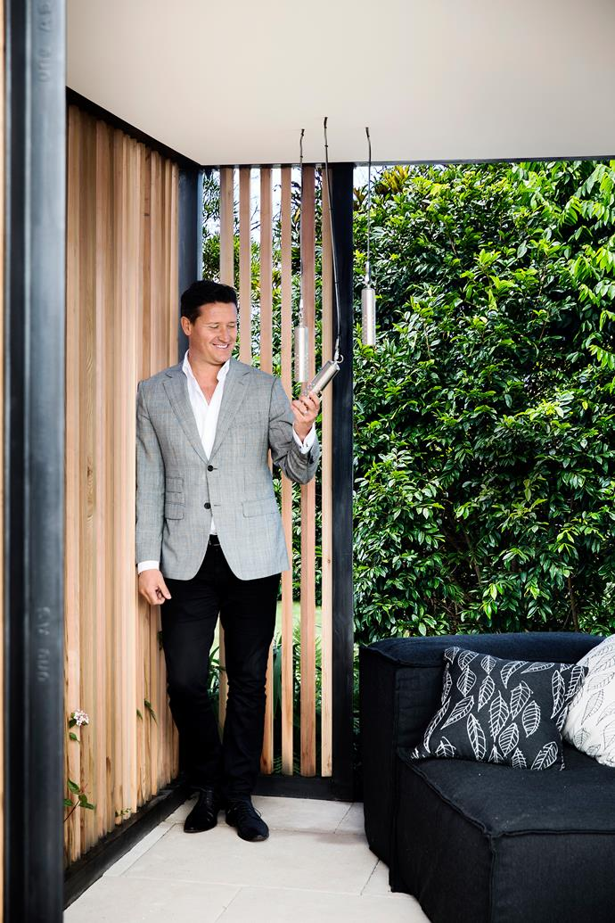 "[Landscape designer Myles Baldwin](http://www.homestolove.com.au/a-luxurious-melbourne-garden-with-a-sydney-look-1600|target=""_blank"") shows off the lighting choices he made for *Open Woodland*, an exhibit at the 2014 Australian Garden Show. *Photo: Chris Warnes*"