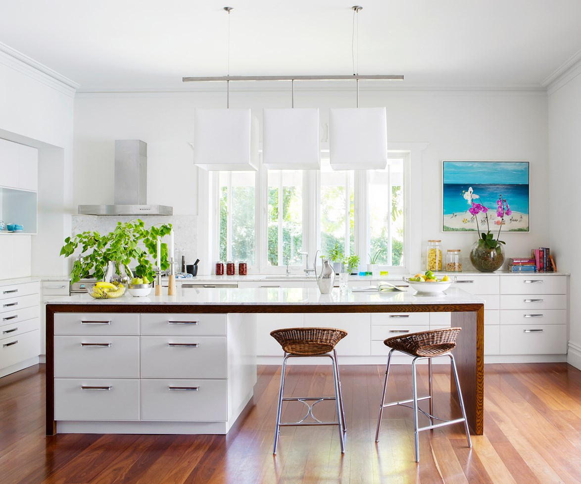 """Sometimes, all a fresh white kitchen needs is a pop or two of bright blue to give it some coastal style. Homeowner Rebecca Warburton, an artist and interior designer, painted the artwork herself, and paintings in similar tones are echoed throughout the house. [Take the tour](http://www.homestolove.com.au/rebecca-and-neils-artful-1920s-home-restoration-1878/?utm_campaign=supplier/
