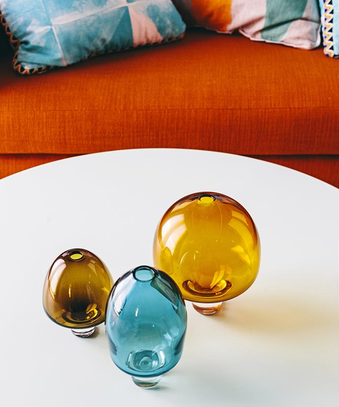 "Burnt orange and cool turquoise hues give off a retro fire-and-ice feel, while Aztec prints shake things up to add extra interest.  Amanda Dziedzic glass **sculptures** from [Koskela](http://www.koskela.com.au/|target=""_blank"")."