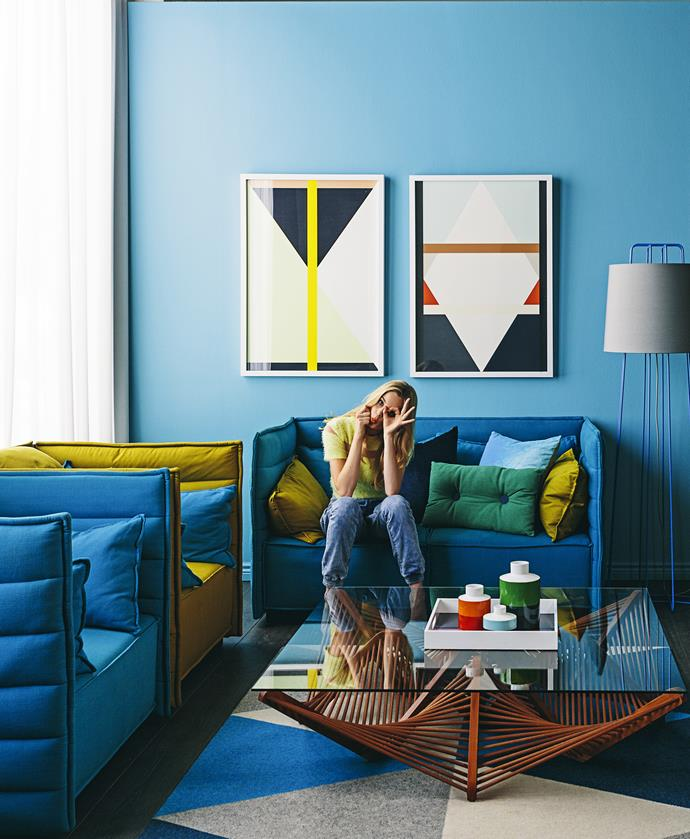 "Colour-block furniture in electric blue and mustard echoes the geometric shapes in the artwork for a bold and playful look.   Vito Geo square **coffee table** in Natural Rattan from [Globe West](http://www.globewest.com.au/|target=""_blank""). Tretford Triangle **rug** from [Koskela](http://www.koskela.com.au/