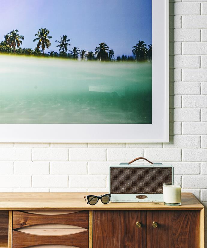"Encourage relaxation at home with a tropical print, framed in white as bright as Hyams Beach sand. Keep the good vibrations going with your favourite cruisy tunes rolling out of a vintage-look speaker.  Maldives photographic **print** by Trevor King from [Urban Couture](https://www.urbancouture.com.au/|target=""_blank""). Bruns **speaker** from [Koskela](http://www.koskela.com.au/