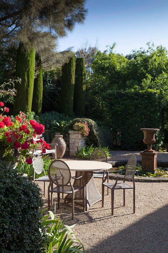 "Urns are gorgeous focal point in a [formal garden](http://www.homestolove.com.au/cascading-formal-garden-on-mount-tambourine-6787|target=""_blank""). Photo: Simon Griffiths / bauersyndication.com.au"