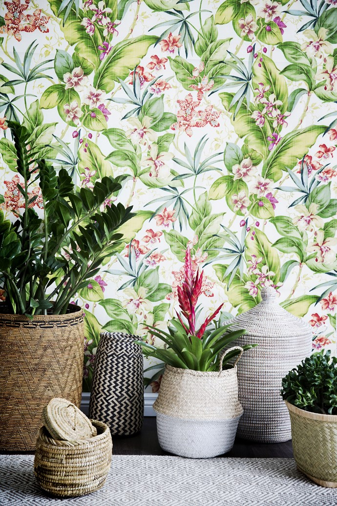 Fresh flowers, botanical prints and rattan furniture hint at outdoor living even on the dreariest of days.