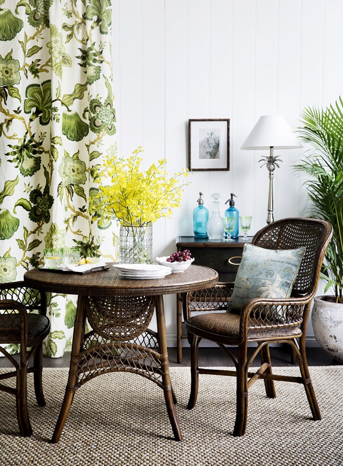 "Use an over-scale print for a curtain, wallpaper or rug as the starting point for your decorating scheme.  **Curtain** in Schumacher Hothouse Flowers linen in Verdance from [Orient House](http://www.orienthouse.com.au/|target=""_blank""). Antique Cane breakfast **table** and **armchairs** from [Laura Kincade](http://www.laurakincade.com/store/