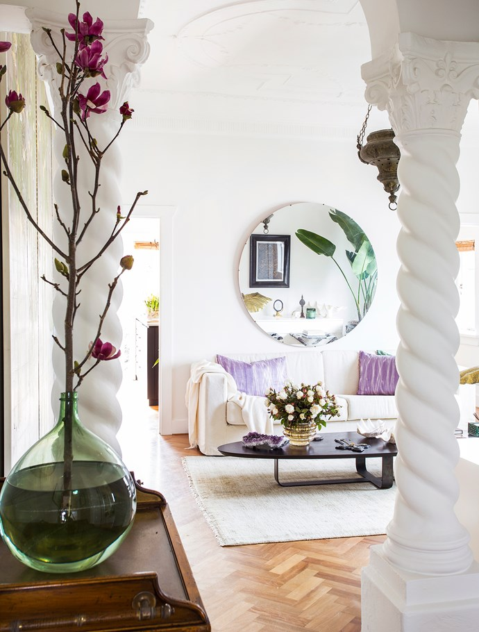 Contemporary and vintage elements mix in the living room, among them the low-slung coffee table, designed by Sarah, and the circular vintage mirror.