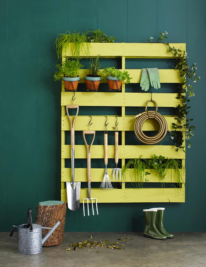 "Reuse and recycle to jazz up an outdoor space. A vibrantly painted pallet is the ideal place to store garden tools and hang herbs for easy access. **PAINT PALETTE:** **Wall** painted in Weathershield in Highland Green, **pallet** in Tarpon Green, log **stool** and plant **pots** in Lilly Pad, all from [Dulux](http://www.dulux.com.au/|target=""_blank""). Burgon & Ball **spade**, **digging fork**, shrub **rake** and **mid-handled fork** from [Quality Products](http://www.qualityproducts.com.au/