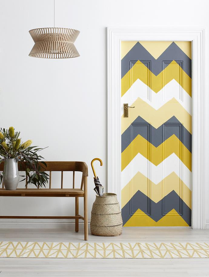 "Give plain doors some love with bold patterns in gorgeous hues. Zig-zag painter's tape is the go-to tool for this job.  **PAINT PALETTE:**Door painted in Interior Expressions Low Sheen in (from top) Cassel Yellow, Sonora Sea, April Sun and Greyology 1. Wall, door frame and skirting in Greyology 1, all from [Haymes Paint](http://www.haymespaint.com.au/|target=""_blank"").   Secto Design Kontro 6000 **pendant light** from [Fred International](http://www.fredishere.com.au/
