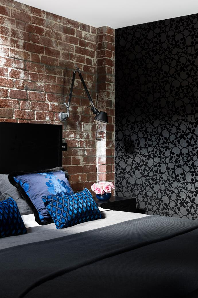 """""""The black flocked wallpaper with skulls on it was the owners' inspiration,"""" says Camilla. """"It certainly makes for a unique bedroom.""""  Barbara Hulanicki Skulls **wallpaper** for [Graham & Brown](http://www.grahambrown.com/