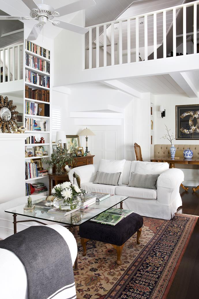 """The coffee table and Turkish rug are treasured pieces. """"Our children always say that wherever we are, it feels like home, as we take our furniture from house to house,"""" says Beverly."""
