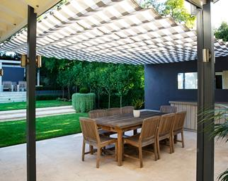 Outdoor dining area under patio roof