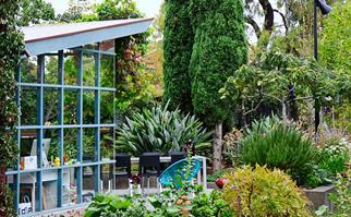 The study overlooks the wild garden.
