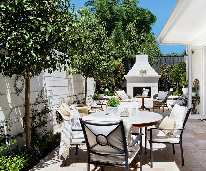 Outdoor dining area with pizza oven