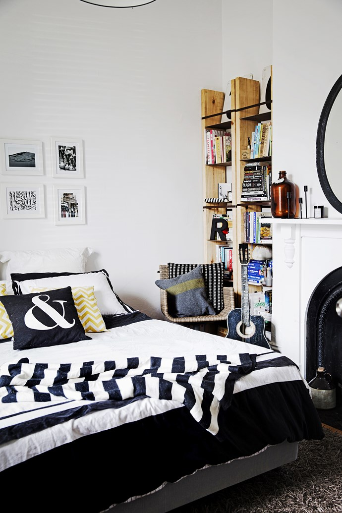 In the guest bedroom, Lance made the custom shelves with steel squares and timber planks using a steel-strapping machine.