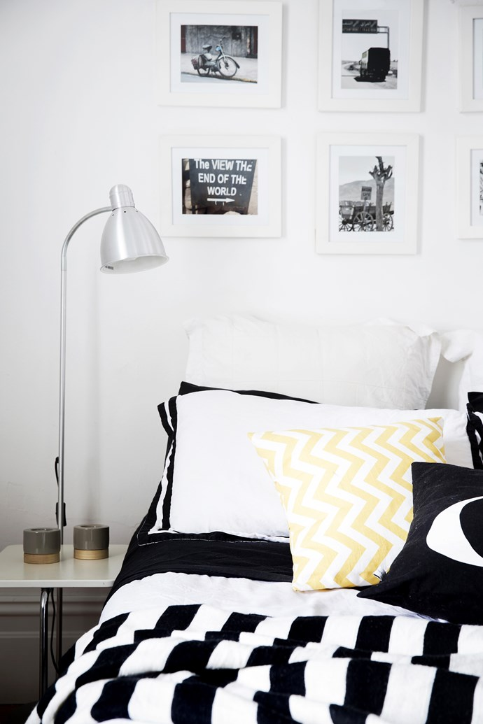 Black-and-white framed photos are an inexpensive way to give a room personality, and the display is in keeping with the home's restrained colour palette.