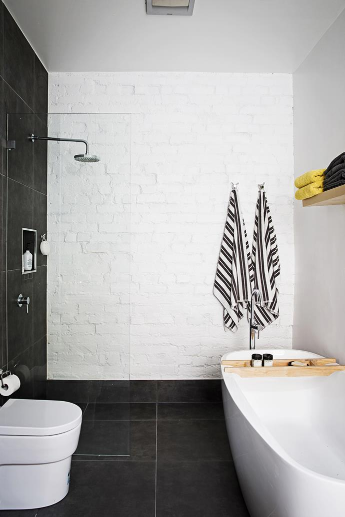 The couple bought all the bathroom fixtures themselves instead of leaving it to tradespeople, saving time and money. The painted brick wall looks great and saved on the tiling budget.