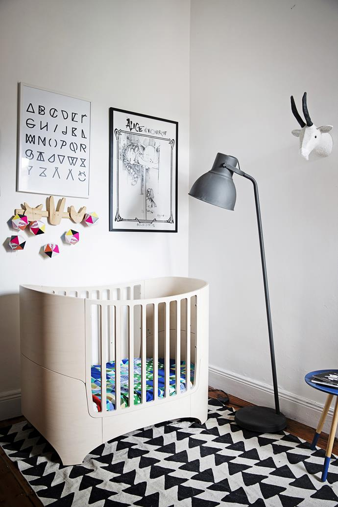 "The black-and-white nursery theme is softened with light timber and colourful linen. Hektar floor lamp in Dark Grey, from [Ikea](http://www.ikea.com/|target=""_blank"")."